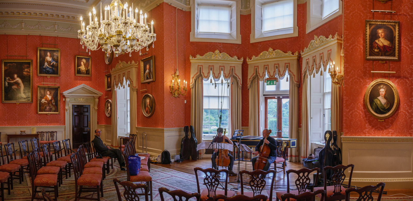 Shot of Henrik and Jon playing, surrounded by ornate decoration and paintings in Weston Park