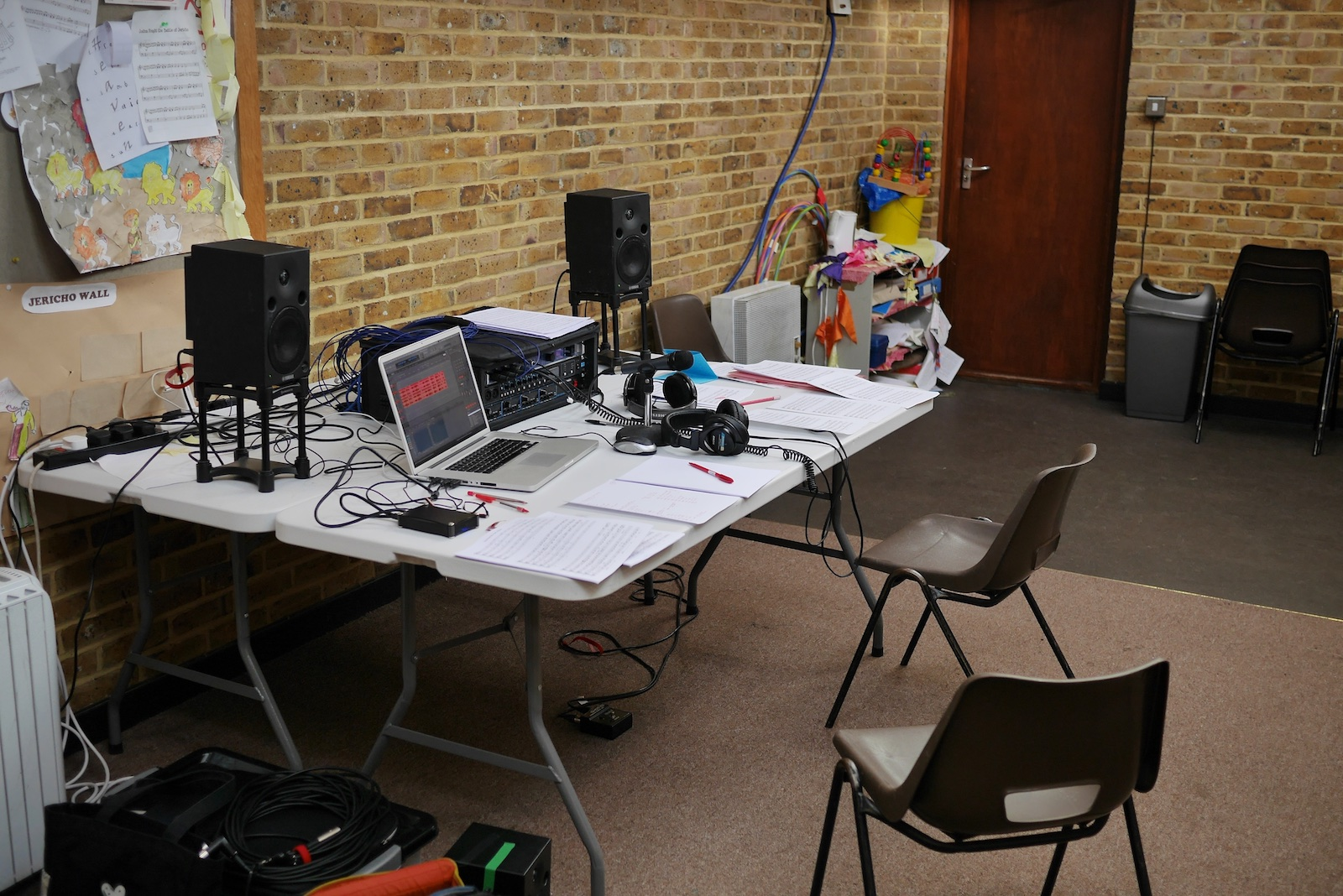 Photo of recording equipment on a table in a room used for sunday school sessions