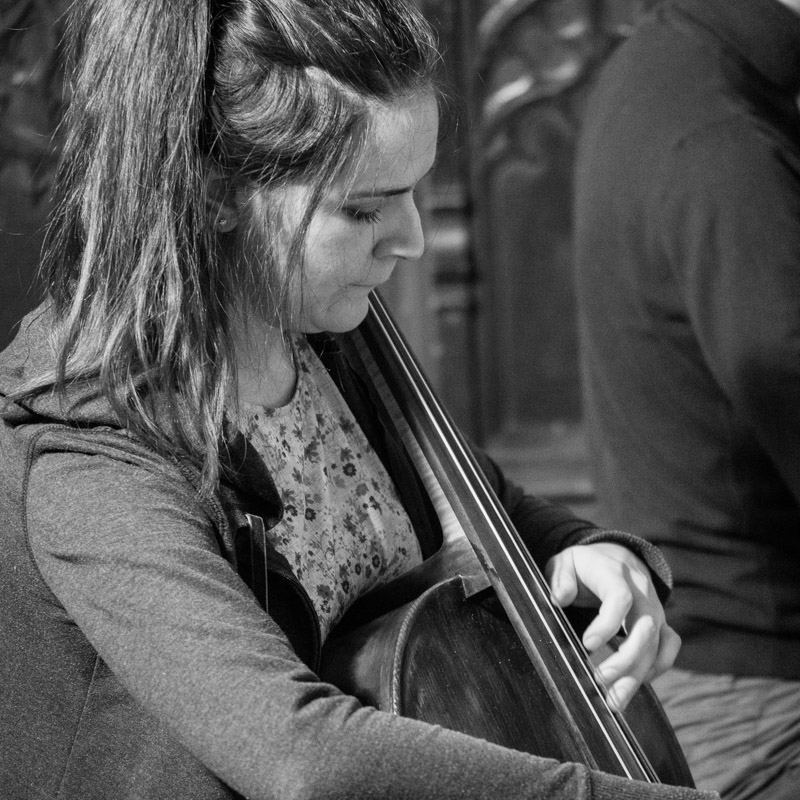 Carina Drury playing a high note on cello